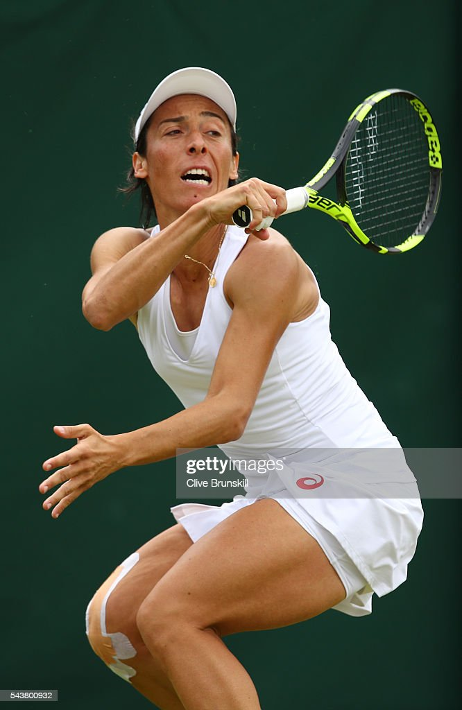 <a gi-track='captionPersonalityLinkClicked' href=/galleries/search?phrase=Francesca+Schiavone&family=editorial&specificpeople=171396 ng-click='$event.stopPropagation()'>Francesca Schiavone</a> of Italy plays a backhand during the Ladies Singles second round match against Simona Halep of Romania on day four of the Wimbledon Lawn Tennis Championships at the All England Lawn Tennis and Croquet Club on June 30, 2016 in London, England.