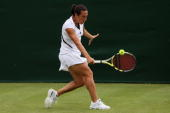 Francesca Schiavone of Italy plays a backhand during the women's singles first round match against Aleksandra Wozniak of Canada on Day One of the...