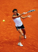 Francesca Schiavone of Italy plays a backhand in her women's singles second round match against Tsvetana Pironkova of Bulgaria during day 5 of the...