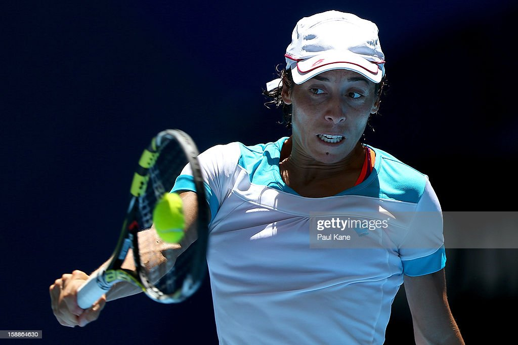 Francesca Schiavone of Italy plays a backhand to Tatjana Malek of Germany in her singles match during day five of the Hopman Cup at Perth Arena on January 2, 2013 in Perth, Australia.