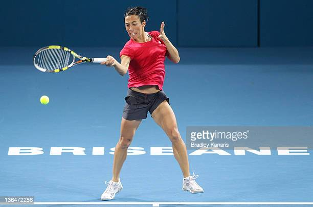 Francesca Schiavone of Italy plays a forehand against Kaia Kanepi of Estonia in their Women's semi final match during day six of the 2012 Brisbane...