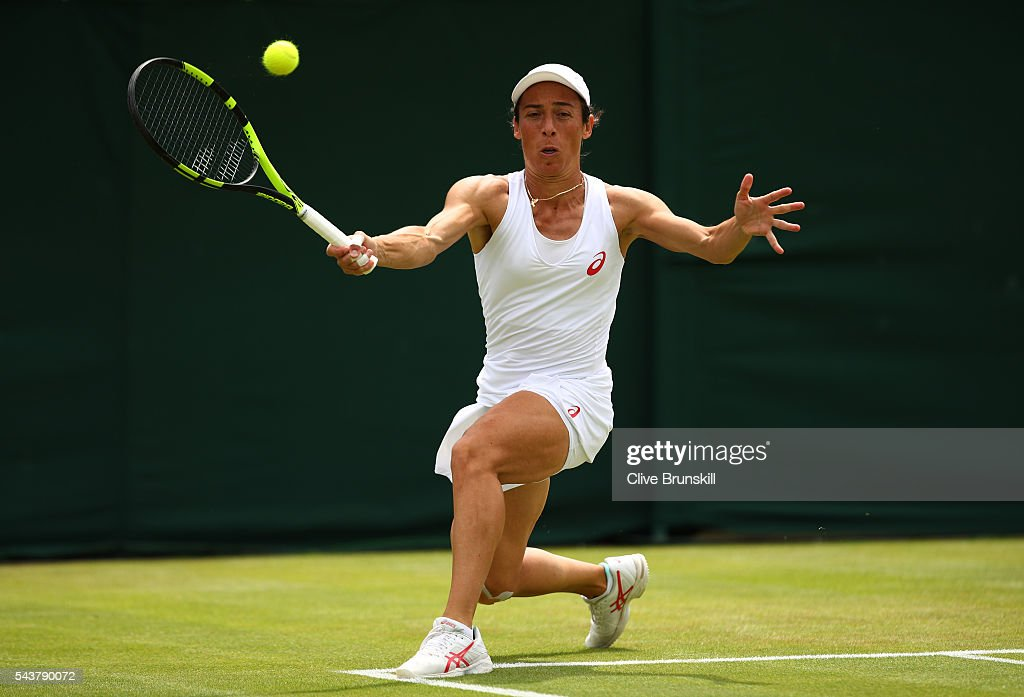 Francesca Schiavone of Italy plays a forehand during the Ladies Singles second round match against Simona Halep of Romania on day four of the Wimbledon Lawn Tennis Championships at the All England Lawn Tennis and Croquet Club on June 30, 2016 in London, England.