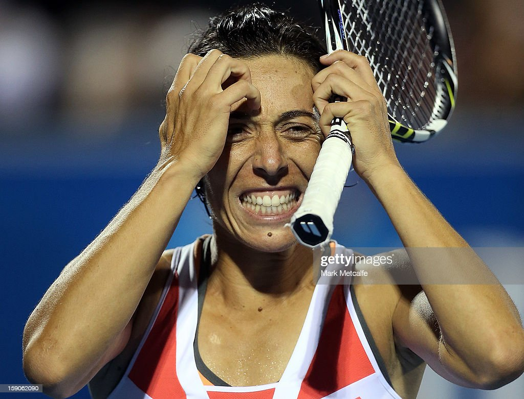 <a gi-track='captionPersonalityLinkClicked' href=/galleries/search?phrase=Francesca+Schiavone&family=editorial&specificpeople=171396 ng-click='$event.stopPropagation()'>Francesca Schiavone</a> of Italy reacts after losing a point in her first round match against Kirsten Flipkens of Belgium during day four of the Hobart International at Domain Tennis Centre on January 7, 2013 in Hobart, Australia.