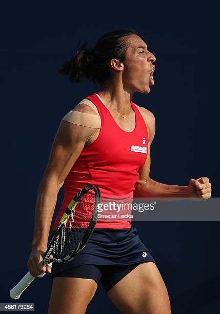 Francesca Schiavone of Italy reacts against Yanina Wickmayer of Belgium during their Women's Singles First Round match on Day Two of the 2015 US Open...