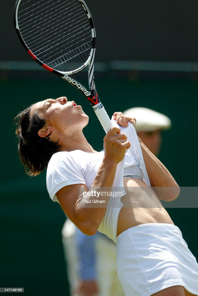 Francesca Schiavone of Italy reacts during her Ladies' Singles first round match against Laura Robson of Great Britain on day two of the Wimbledon Lawn Tennis Championships at the All England Lawn Tennis and Croquet Club on June 26, 2012 in London, England.