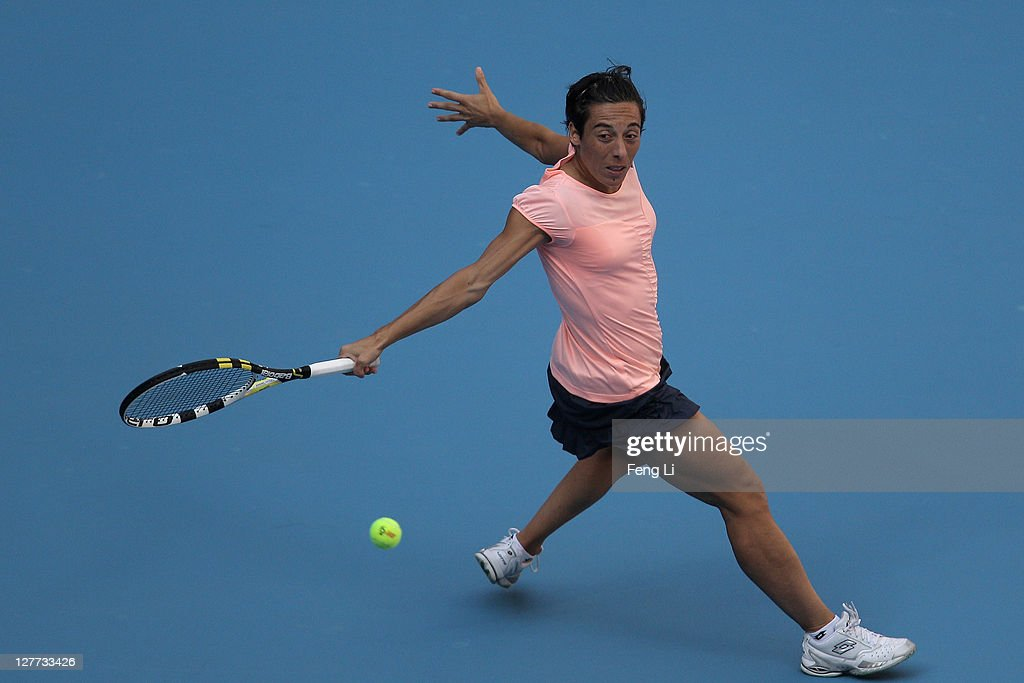 <a gi-track='captionPersonalityLinkClicked' href=/galleries/search?phrase=Francesca+Schiavone&family=editorial&specificpeople=171396 ng-click='$event.stopPropagation()'>Francesca Schiavone</a> of Italy returns a shot against <a gi-track='captionPersonalityLinkClicked' href=/galleries/search?phrase=Bojana+Jovanovski&family=editorial&specificpeople=4836646 ng-click='$event.stopPropagation()'>Bojana Jovanovski</a> of Serbia during day one of the 2011 China Open at the National Tennis Centre on October 1, 2011 in Beijing, China.