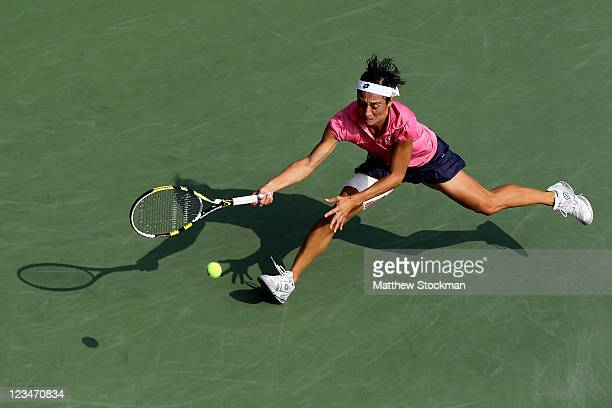 Francesca Schiavone of Italy returns a shot against Chanelle Scheepers of South Africa during Day Six of the 2011 US Open at the USTA Billie Jean...