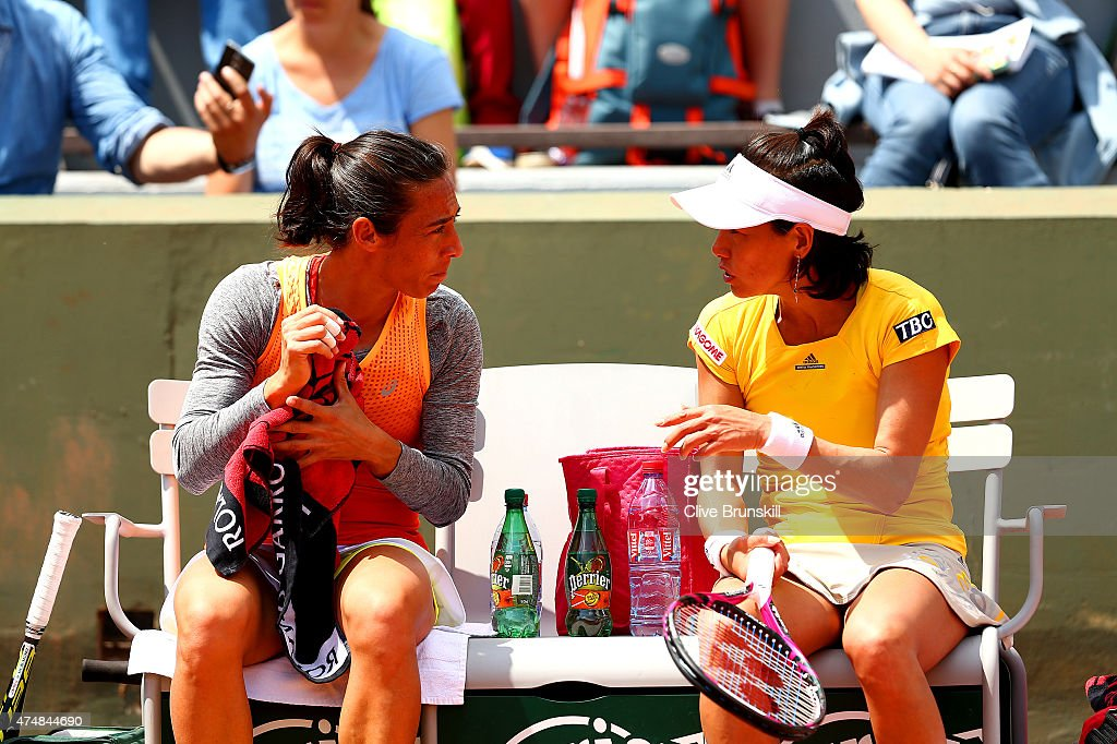 Francesca Schiavone of Italy talks to Kimiko DateKrumm of Japan during a break in play in their Women's Doubles match against Petra Cetkovska of...