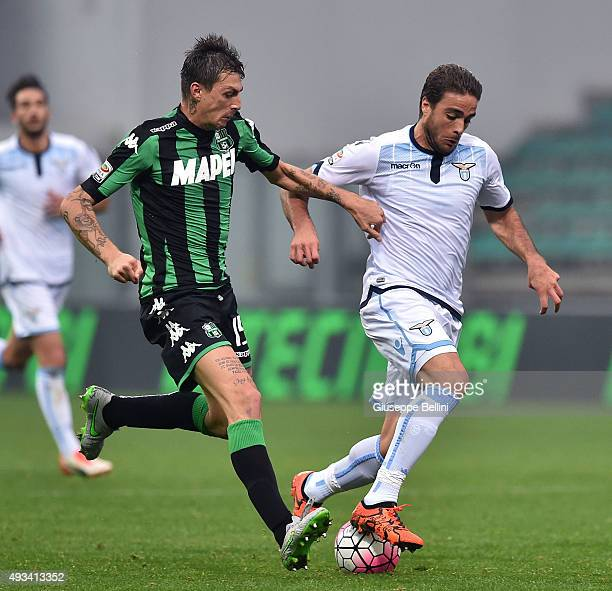 Francesco Acerbi of Sassulo and Alessandro Matri of Lazio in action during the Serie A match between US Sassuolo Calcio and SS Lazio at Mapei Stadium...