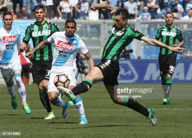 Francesco Acerbi of Sassuolo competes for the ball with Allan of Napoli during the Serie A match between US Sassuolo and SSC Napoli at Mapei Stadium...