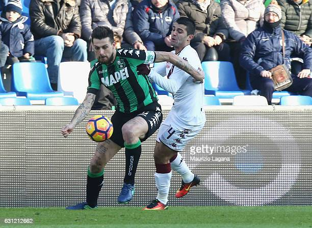 Francesco Acerbi of Sassuolo competes for the ball with Iago Falque of Torino during the Serie A match between US Sassuolo and FC Torino at Mapei...