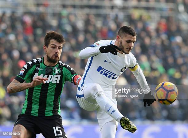 Francesco Acerbi of Sassuolo competes for the ball with Mauro Icardi of Inter during the Serie A match between US Sassuolo and FC Internazionale at...