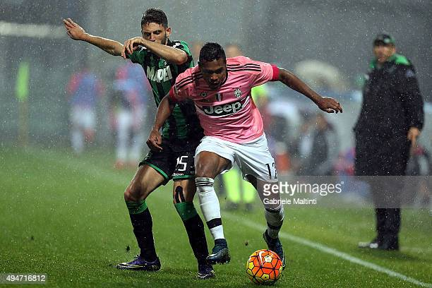 Francesco Acerbi of US Sassuolo Calcio battles for the ball with Alex Sandro of Juventus FC during the Serie A match between US Sassuolo Calcio and...
