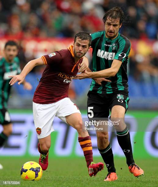 Francesco Acerbi of US Sassuolo Calcio competes for the ball with Miralem Pjanic of AS Roma during the Serie A match between AS Roma and US Sassuolo...