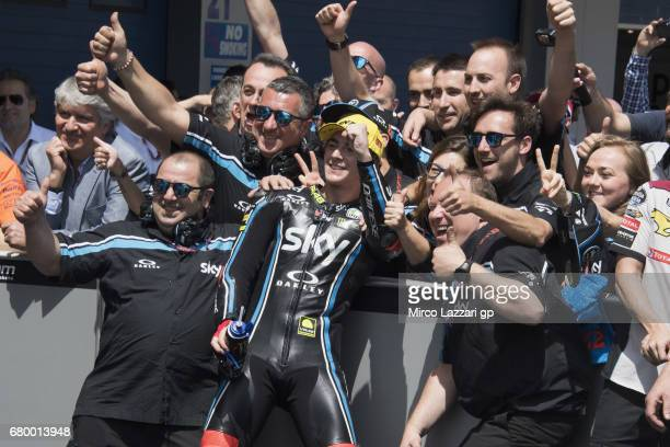 Francesco Bagnaia of Italy and Sky Racing Team VR46 celebrates the second place with team under the podium at the end of the Moto2 race during the...