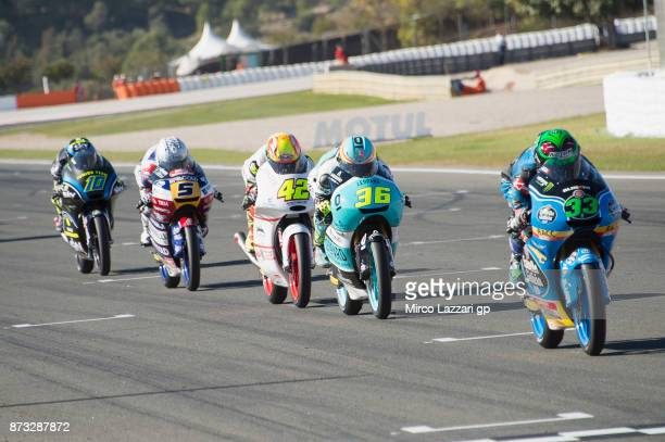 Francesco Bagnaia of Italy and Sky Racing Team VR46 Enea Bastianini of Italy and Estrella Galicia 00 leads the field during the Moto3 race during the...
