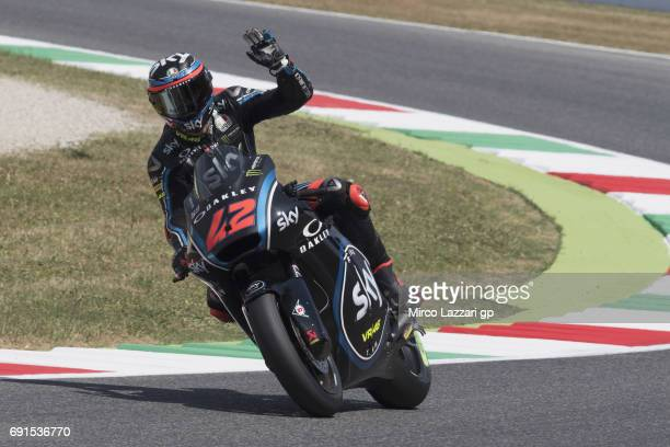Francesco Bagnaia of Italy and Sky Racing Team VR46 greets the fans during the MotoGp of Italy Free Practice at Mugello Circuit on June 2 2017 in...