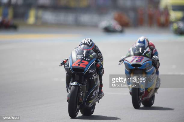 Francesco Bagnaia of Italy and Sky Racing Team VR46 leads Alex Marquez of Spain and EG 00 Marc VDS during the Moto2 race during the MotoGp of France...