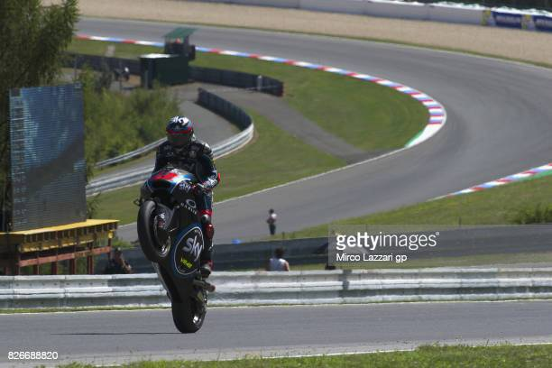 Francesco Bagnaia of Italy and Sky Racing Team VR46 lifts the front wheel during the MotoGp of Czech Republic Qualifying at Brno Circuit on August 5...