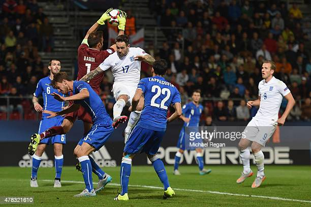 Francesco Bardi of Italy collects the ball under pressure from Danny Ings during the UEFA Under21 European Championship match between England and...