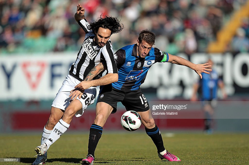 Francesco Bolzoni of AC Siena fights for the ball with German Gustavo Denis of Atalanta BC during the Serie A match between AC Siena and Atalanta BC at Stadio Artemio Franchi on March 3, 2013 in Siena, Italy.