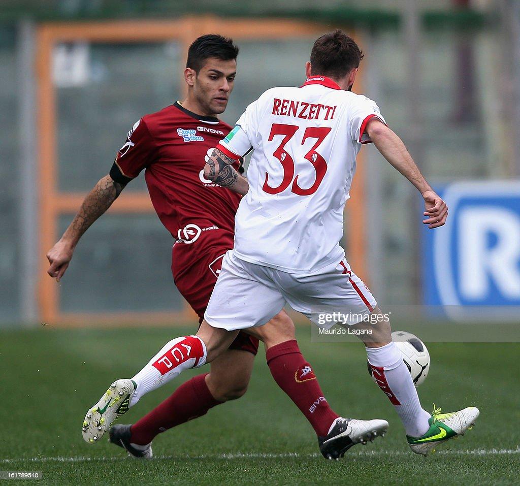 Francesco Bombagi of Reggina (L) competes for the ball with Francesco Renzatti of Padova during the Serie B match between Reggina Calcio and Calcio Padova on February 16, 2013 in Reggio Calabria, Italy.