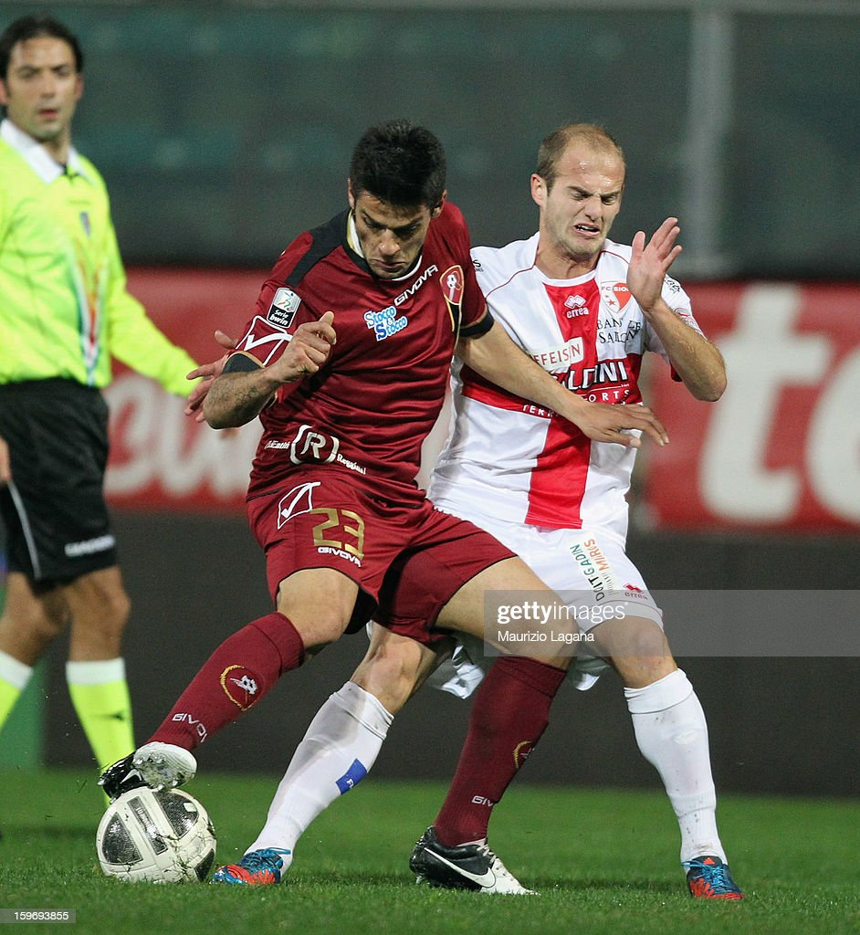 Francesco Bombagi (L) of Reggina competes for the ball with Vullnet Basha of Sion during the friendly match between Reggina Calcio and FC Sion on January 18, 2013 in Reggio Calabria, Italy.