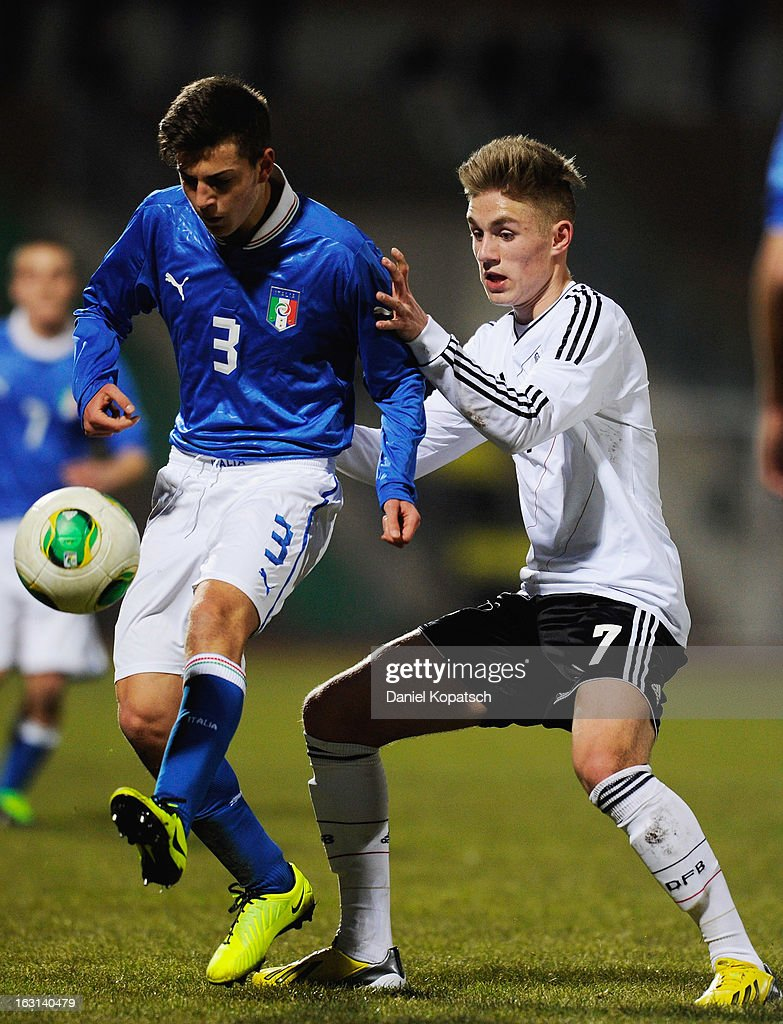 Francesco Bordi of Italy (L) is challenged by Leandro Putaro of Germany during the U16 international friendly match between Germany and Italy on March 5, 2013 at Waldstadion in Homburg, Germany.