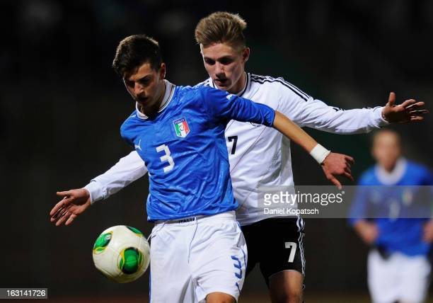 Francesco Bordi of Italy is challenged by Leandro Putaro of Germany during the U16 international friendly match between Germany and Italy on March 5...