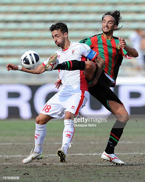 Francesco Caputo of Bari is challenged by Crocefisso Miglietta of Ternana during the Serie B match between AS Bari and Ternana Calcio at Stadio San...