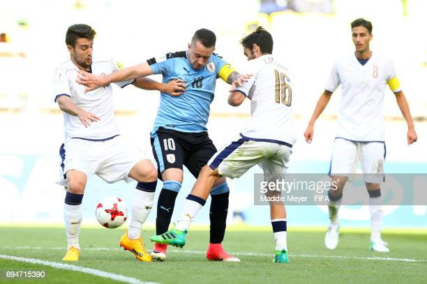 Francesco Cassata and Riccardo Marchizza defend Rodrigo Amaral of Uruguay during the FIFA U20 World Cup Korea Republic 2017 3rd rank playoff match at...
