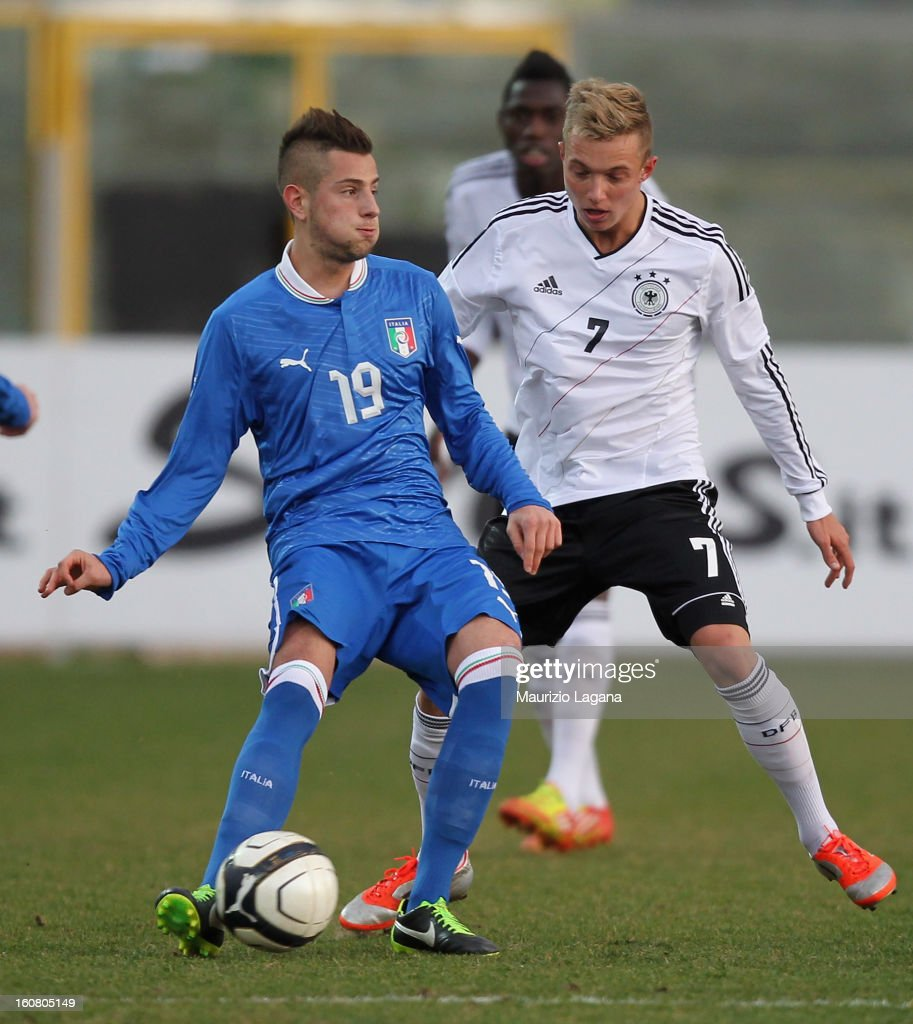 Francesco Fedato (L) of Italy competes for the ball with Sonny Kittel of Germany during U20 International Friendly match between Italy and Germany at Stadio Cosimo Puttilli on February 6, 2013 in Barletta, Italy.
