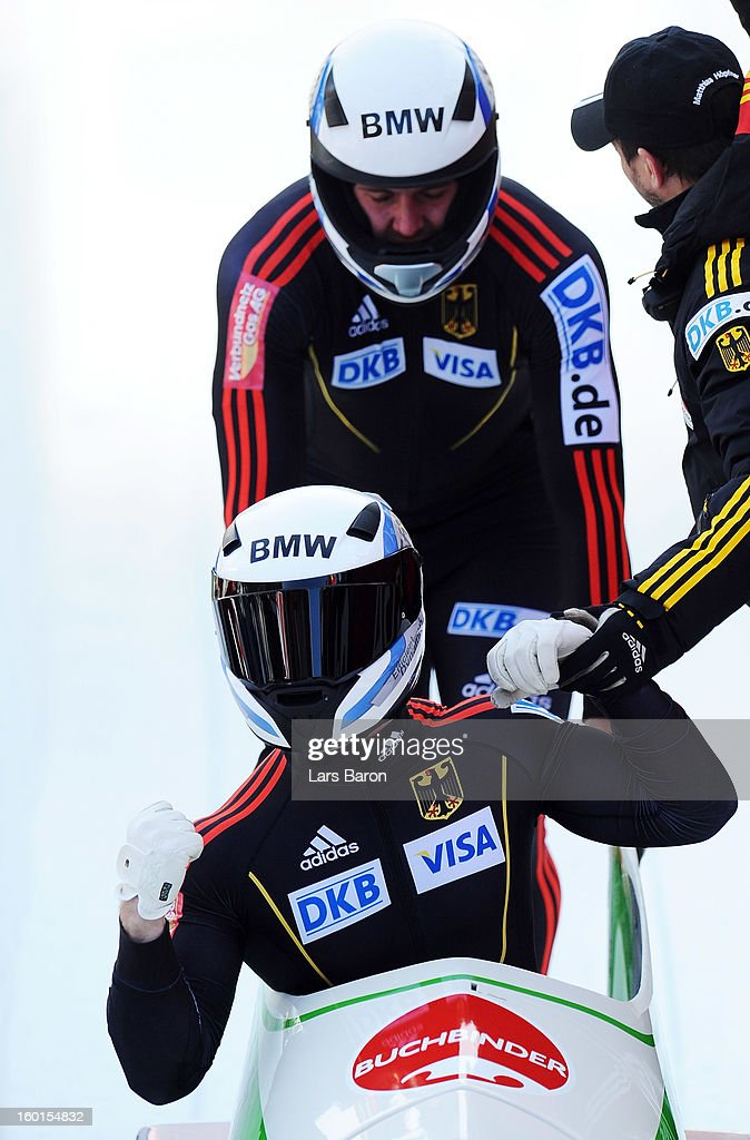 Francesco Friedrich and Jannis Baecker of Germany celebrate after winning the Two Men Bobsleigh final heat of the IBSF Bob & Skeleton World Championship at Olympia Bob Run on January 27, 2013 in St Moritz, Switzerland.