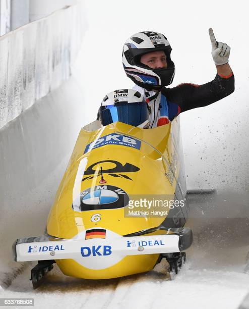 Francesco Friedrich and Thorsten Margis of Germany celebrate after the final run of the 2man Bobsleigh BMW IBSF World Cup at Olympiabobbahn Igls on...