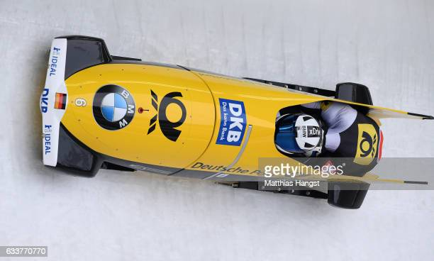 Francesco Friedrich and Thorsten Margis of Germany competes during first run of the 2man Bobsleigh BMW IBSF World Cup at Olympiabobbahn Igls on...