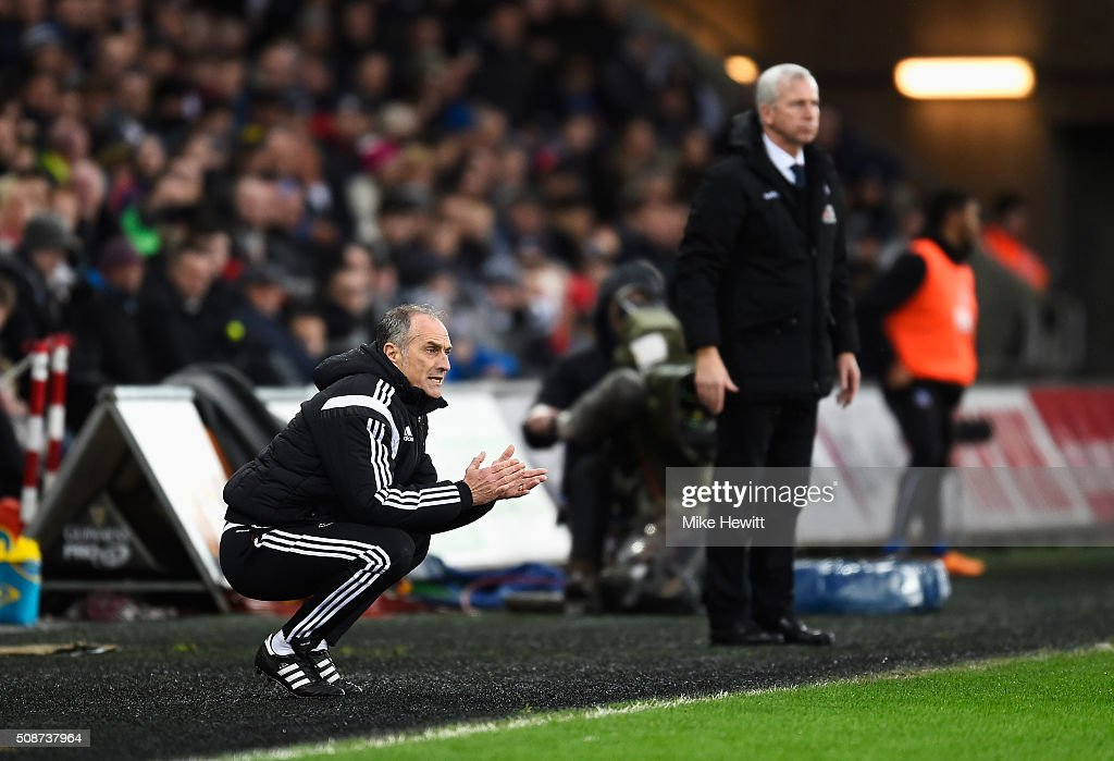 <a gi-track='captionPersonalityLinkClicked' href=/galleries/search?phrase=Francesco+Guidolin&family=editorial&specificpeople=770478 ng-click='$event.stopPropagation()'>Francesco Guidolin</a>, Manager of Swansea City and <a gi-track='captionPersonalityLinkClicked' href=/galleries/search?phrase=Alan+Pardew&family=editorial&specificpeople=171147 ng-click='$event.stopPropagation()'>Alan Pardew</a> Manager of Crystal Palace look on during the Barclays Premier League match between Swansea City and Crystal Palace at the Liberty Stadium on February 6, 2016 in Swansea, Wales.