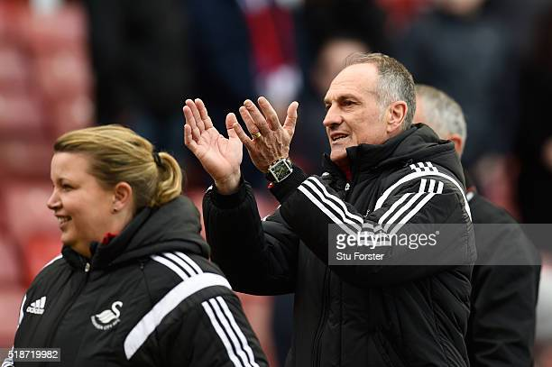 Francesco Guidolin Manager of Swansea City applauds the away supporters after the Barclays Premier League match between Stoke City and Swansea City...