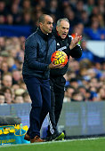 Francesco Guidolin Manager of Swansea City encourages his players next to Roberto Martinez Manager of Everton during the Barclays Premier League...