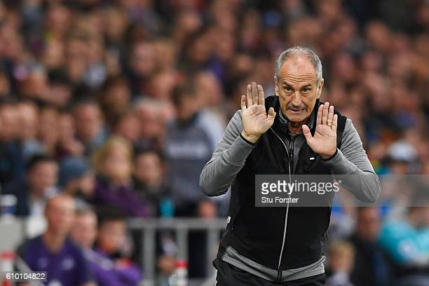Francesco Guidolin Manager of Swansea City gives his team instructions during the Premier League match between Swansea City and Manchester City at...