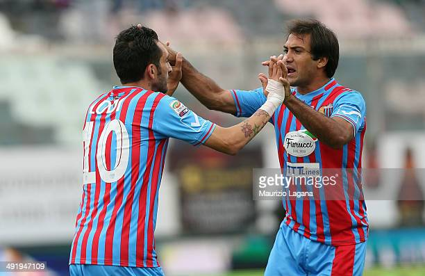 Francesco Lodi of Catania celebrates after scoring the opening goal with his teammate Fabian Rinaudo during the Serie A match between Calcio Catania...