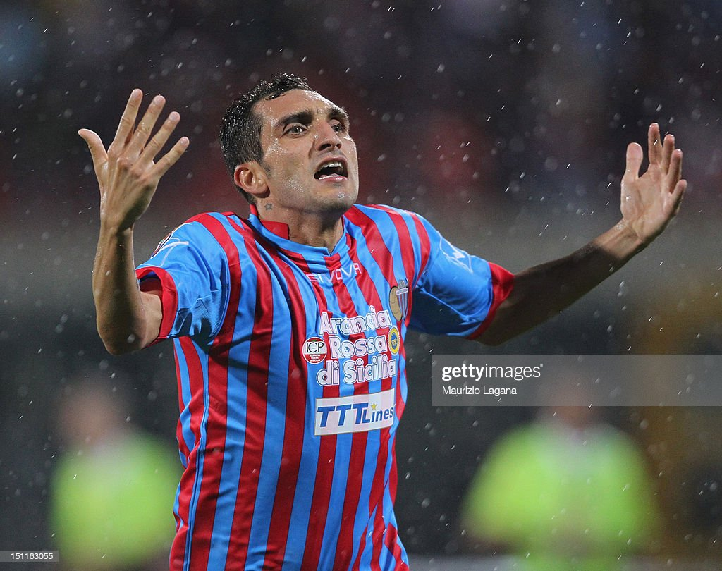 Francesco Lodi of Catania celebrates after scoring the winning goal during the Serie A match between Calcio Catania and Genoa CFC at Stadio Angelo...