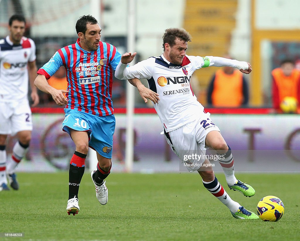 Francesco Lodi (L) of Catania competes for the ball with Alessandro Diamanti of Bologna during the Serie A match between Calcio Catania and Bologna FC at Stadio Angelo Massimino on February 17, 2013 in Catania, Italy.