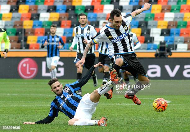 Francesco Lodi of Udinese Calcio competes with Marco Dalessandro of Atalanta BC during the Serie A match between Udinese Calcio v Atalanta BC at...