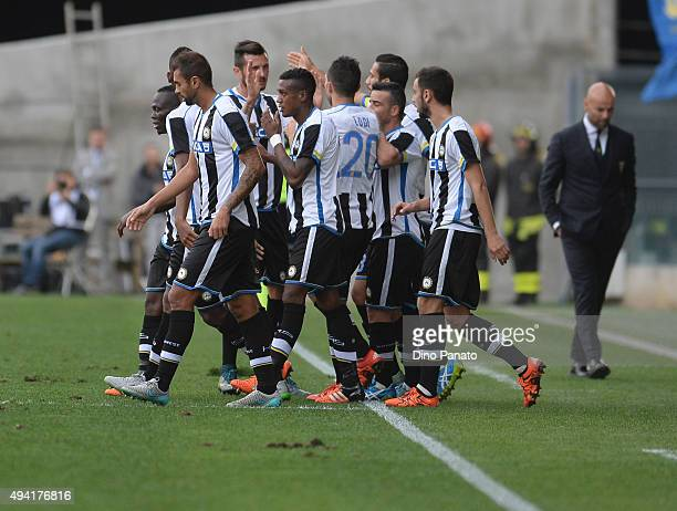 Francesco Lodi of Udinese Calcio is mobbed by team mates after scoring his team's second during the Serie A match between Udinese Calcio and...