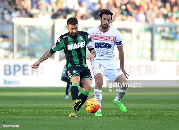 Francesco Magnanelli of Sassuolo Calcio competes with Cristian Zaccardo of Carpi FC during the Serie A match between US Sassuolo Calcio and Carpi FC...