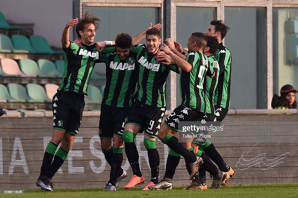 Francesco Magnanelli (L) of Sassuolo scores with team mates after scoring second goal during the Serie A match between US Sassuolo Calcio and US Citta di Palermo at Mapei Stadium - Città del Tricolore on February 7, 2016 in Reggio nell'Emilia, Italy.