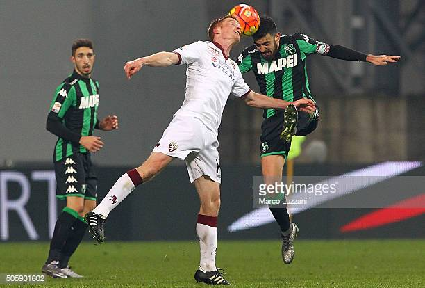 Francesco Magnanelli of US Sassuolo Calcio competes for the ball with Alessandro Gazzi of Torino FC during the Serie A match betweeen US Sassuolo...