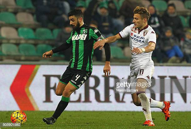 Francesco Magnanelli of US Sassuolo Calcio is challenged by Ciro Immobile of Torino FC during the Serie A match betweeen US Sassuolo Calcio and...