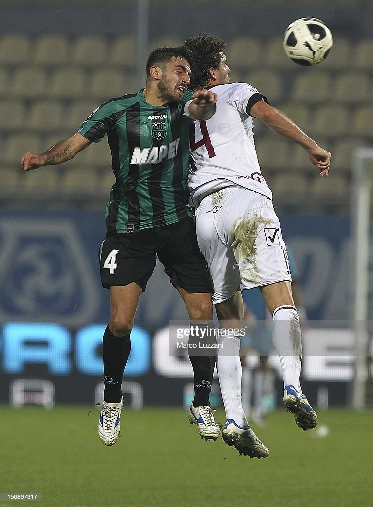 Francesco Magnanelli of US Sassuolo competes for the ball with Mehmet Hetemaj of Reggina Calcio during the Serie B match between US Sassuolo and Reggina Calcio at Alberto Braglia Stadium on November 24, 2012 in Modena, Italy.