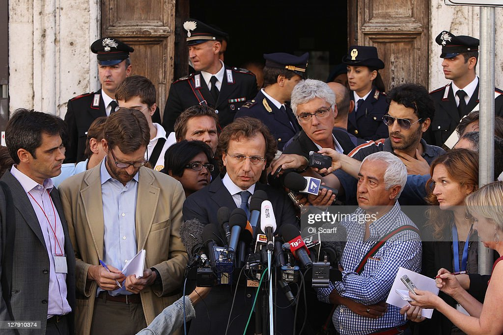 Francesco Maresca (C), the lawyer representing Meredith Kercher's family, reads a statement outside Perugia's Court of Appeal prior to the verdict in the appeal of Amanda Knox and Raffaele Sollecito's murder convictions on October 3, 2011 in Perugia, Italy. American student Amanda Knox and her Italian ex-boyfriend Raffaele Sollecito were convicted in 2009 of killing their British roommate Meredith Kercher in Perugia, Italy in 2007. The jury in their appeal is expected to retire to consider their verdict later today. They have served nearly four years in jail after being sentenced to 26 and 25 years respectively.